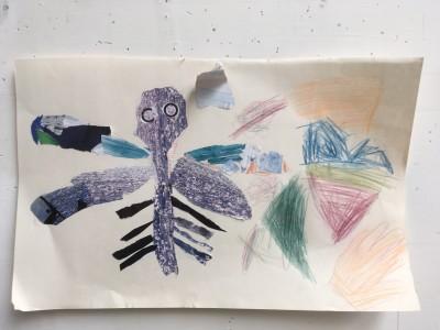 Een collage van een Libelle op papier. Met stukken foto's uit een tijdschrift