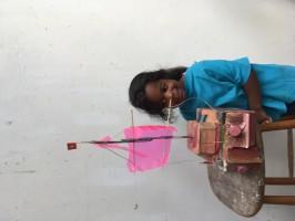 Wind-zeilboot door L. 4 jaar oud. Gemaakt van restmateriaal, zoals melkpakken, een botervlootje, plakband, verpakkingsmateriaal, touw, stokjes