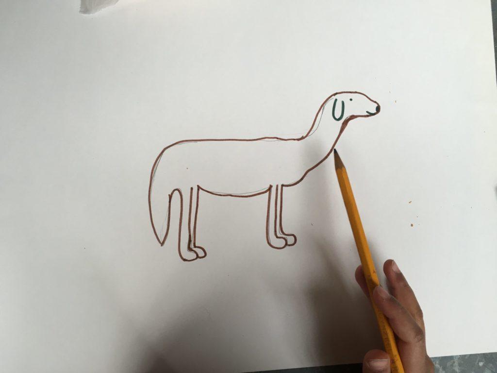 De tekening van de hond nu in stift